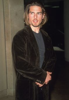 Tom Cruise.  does he not realize he looks like an idiot with that hair