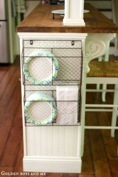 Wire basket for storage on side of kitchen island with bead board, part of Ikea Hack Kitchen Island via www.goldenboysandme.com