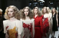 Models wear creations for Bottega Veneta women's Fall-Winter 2013-14 collection, part of the Milan Fashion Week, unveiled in Milan, Italy, Saturday, Feb. 23, 2013. (AP Photo/Antonio Calanni)