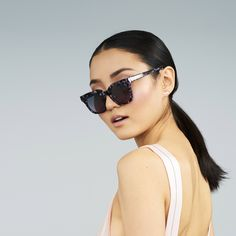 "Instant pizazz. Shop the Covry ""Kraz"" sunglasses in mulberry, $95,  for a pop of color."