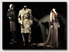 The fashion world of Jean Paul Gaultier: From the sidewalk to the catwalk. Etoiles and toiles gown from the Movie Stars (or Cinema) haute couture collection from F/W 2009-2010 or the Male Faces motif riding coat from his Photography Maniacs Mens F/W 1992-1993 prêt-a-porter collection
