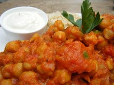 chana masala  1 15oz Can chickpeas, drained and rinsed 2 tbs. Tomato paste + extra for desired consistency 1 Medium onion, diced 3 Tomatoes, cut top off and squeeze juice out 3 Cloves garlic, sliced 1 jalapeno pepper, I like it with the seeds(for more heat), sliced 1 tsp Chili powder 1 tsp Coriander 1 tsp Garam masala 1/2 tsp Cumin 1/2 tsp Cinnamon 1/2 tsp Salt Brown Rice Greek Yogurt