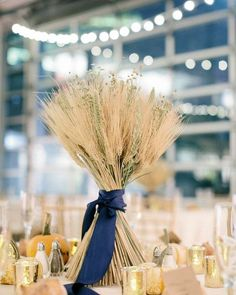 @curiouscountry posted to Instagram: This gorgeous table centerpiece is a show-stopper!  Get this look by purchasing a Mixed Grain Wheat Bundle (smart bio link in our bio), and tying it with a satin ribbon.  Give the stems a little twist to spread them out and it will stand up on its own.  That's easy right?!  Try it for your next special event, or even to dress up your farmhouse dining room.  #weddinginspo #weddingreception #receptionideas #bohowedding #weddingideas #weddingdecor #weddingbouque