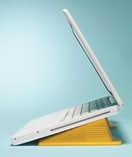 DIY Dorm Idea: Rubber doorstops as laptop risers help your computer keep its cool. The extra elevation also allows air to circulate & prevents overheating.