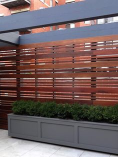 A Chicago rooftop fence by Topiarius in a horizontal design is made of Ipe, a type of hardwood, and oiled for rich color.
