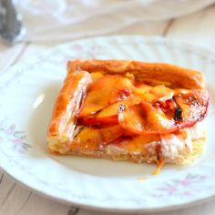 Grilled peaches and cream cheese on a buttery flaky crust. THE dessert for your summer