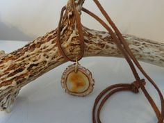 Genuine Deer Antler Necklace With Rawhide by TheElusiveWolf