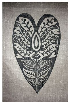 Hand lino printed linen cushion cover with heart design. $40.00, via Etsy.