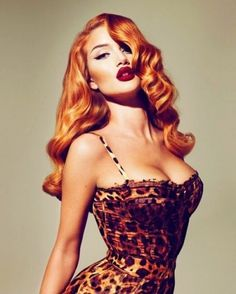 Perfect hair and leopard bustier. Maybe w pencil skirt ...