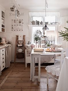 A bit cluttered, but my kitchen usually is. Once again, love the white/neutrals.