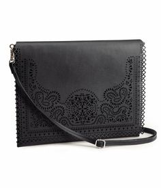$34.95 DESCRIPTION Clutch bag in imitation leather with decorative openwork pattern on flap