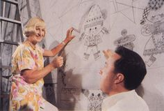 A rare picture of Mary Blair at work on the design of the attraction...