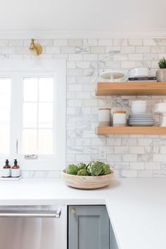 5 Kitchens That Inspire: Counter to ceiling marble subway tile.
