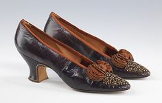 Evening slippers Hook, Knowles & Co. (British) Date: ca. 1897 Culture: British Medium: leather, silk Dimensions: 5 x 8 in. (12.7 x 20.3 cm) Credit Line: Brooklyn Museum Costume Collection at The Metropolitan Museum of Art, Gift of the Brooklyn Museum, 2009; Gift of the Princess Viggo in accordance with the wishes of the Misses Hewitt, 1931 Accession Number: 2009.300.1418a, b