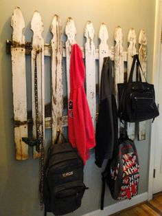 Fence coat rack/  portion of old picket fence remade into this coat rack using IKEA door stops! Awesomeness///I have a ancient gate..no pickets tho