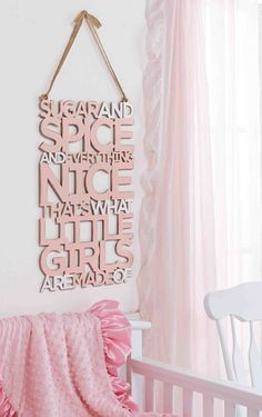 A fun and whimsical addition to baby girl's room with the classic Little Girls rhyme. This laser cut, painted and distressed word art features pink dimensional cut out accents and a burlap display hanger. Dimensions are 21 x 14.