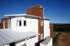 AECweb | Telhas termoacústicas compõem empreendimento sustentável em praia do ES