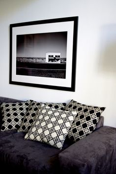 Modern and graphic, our British Cane black and white pillows adds a polished touch to any home. Prada Marfa print by Gray Malin.