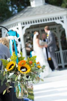 Shepard's hooks are a great way to decorate the isle in the summer, specially with sunflowers!   The Chateaux at Fox Meadows   Booze Photography  