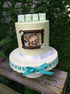 """Yellow 6"""" cake ganache and fondant covered. Hand painted bear with marker and edible color dust."""
