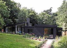 Black brick house in the woods by Takero Shimazaki and Charlie Luxton. I love how the house almost disappears Black Architecture, Architecture Design, 1960s House, Flat Roof House, Black House Exterior, Modernisme, Dark House, Black Brick, Brickwork