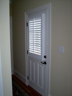 Plantation Shutters On The Window Portion Of A Door. Love The Dark Hardware  On The