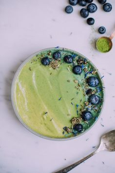 A simple mango smoothie bowl with sweet peas for protein, B Vitamins and an essential hit of greens. Low glycemic, vegan and easy to modify.
