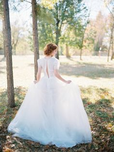 I love the back of this gown! | http://emmalinebride.com/bride/wedding-gown-with-short-lace-sleeves/