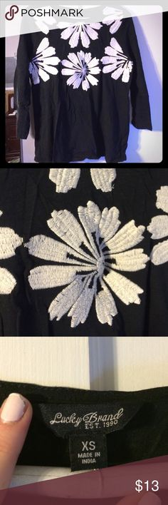 Embroidered Flower tshirt 3/4 sleeves This black shirt is made from comfortable tshirt material but is dressed up by the gorgeous embroidered flowers on the bust. It's labeled extra small but I'd say it's closer to a S-M. Lucky Brand Tops Tees - Long Sleeve