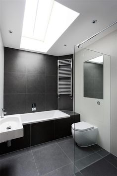 WALL TILES AND TOWEL RADIATOR MOUNTED HIGH UP