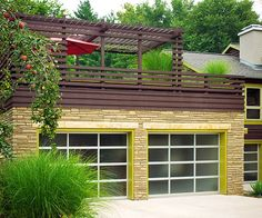 These streamline garage doors fit perfectly with the contemporary feel of this home. More great garage doors: http://www.bhg.com/home-improvement/garage/ideas-inspiration/garage-door-styles/?socsrc=bhgpin052213chartreusegarage=4