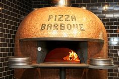 Pizza Barbone Restaurant & Catering, Authentic Wood Fired Pizza in Hyannis, MA. Our restaurant has a very unique and special feature by way of it's Stefano Ferrara wood fired oven. This oven is handmade out of rock and ash from Mt. Vesuvius. All 6,000 lbs of oven sailed it's way over from Naples, Italy right to our doorstep. It's beautiful glass tile overlay shines almost as brightly as the 1000 degree wood burning flame in it's interior! Cape Cod restaurants