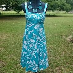 Turquoise and white summer dress Bright turquoise and white summer dress. Straps are adjustable with button. Padded bra and lined bodice, back zipper with elastic gather for nice stretch. Material is cotton spandex blend. R&K Origionals Dresses