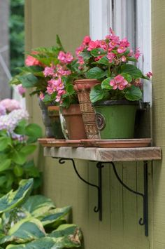 Of course! Use a reclaimed wood shelf and pots as a window box.