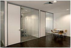 Two New Glass Doors By Optima Systems Can Be Used In Seamless Conjunction With Optima's Other Glass Partitioning Products
