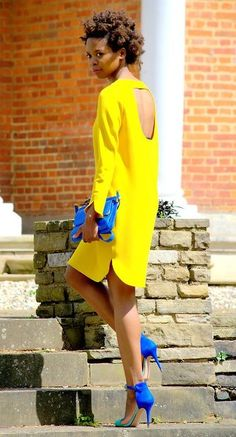 Shop this look on Lookastic:  https://lookastic.com/women/looks/yellow-shift-dress-blue-suede-heeled-sandals-blue-leather-crossbody-bag/11099  — Yellow Shift Dress  — Blue Leather Crossbody Bag  — Blue Suede Heeled Sandals