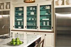 Love the color inside the cabinets!