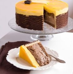 A delicious almond chocolate cake, chocolate mousse, mango mousse topped with a mirror glaze of mango. Beautiful luxury dessert for that very special occasion. Mango Chocolate, Chocolate Cake, Almond Chocolate, Chocolate Mouse, Sweet Recipes, Cake Recipes, Dessert Recipes, Cupcakes, Cupcake Cakes