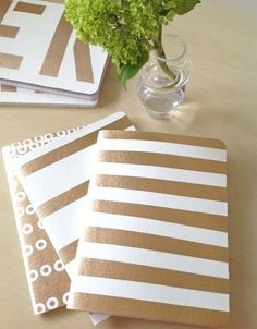 Glamorous Stripped and Monogrammed DIY notebooks with vinyl fabric and gold spray paint! mydearirene.com