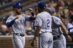Texas Rangers catcher Jonathan Lucroy, left, is congratulated by Hanser Alberto after scoring against the Baltimore Orioles on a single by Elvis Andros during the eighth inning in Baltimore, Tuesday, Aug. 2, 2016. The Orioles won 5-1. (AP Photo/Gail Burton)