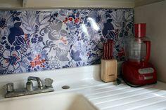 IKEA fabric hung behind plexiglass- DIY backsplash solution for rental kitchens. Vinyl Backsplash, Removable Backsplash, Faux Brick Backsplash, Kitchen Backsplash, Kitchen Pegboard, Backsplash Ideas, Ikea Kitchen, Kitchen Storage, Ikea Fabric