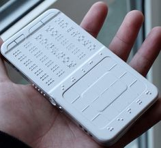 IT • GADGETS • DrawBraille Mobile Phone  ·············································································································  Is a cell phone that uses a braille board and finger pads that allow the blind to communicate efficiently. And this isn't any old phone either – the design includes a book reader, text messaging, email, and even music capabilities. Phone has two main pieces. The first is comprised of 35 braille buttons in five rows....click thru for more