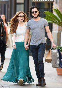 Holding hands: The co-stars looked very much like a couple as they strolled along the bust...