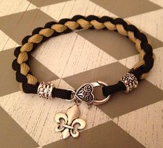 Black and gold paracord bracelet with fleur by BayouCordCreations, $15.00