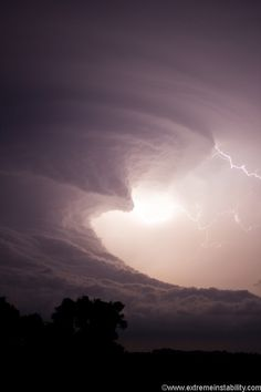 Supercell thunderstorm as night approaches. It looks like a wave about crash down.