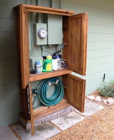 Outdoor armoire to hide hose and other gardening supplies