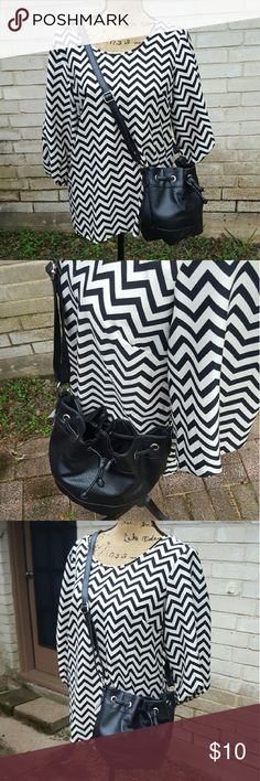 """NWT Black Pleather Drawstring Handbag Satchel New with tags black pleather drawstring roomy handbag. Adjustable long strap can be worn crossbody style as shown. Inside small zipper side pocket. Brushed nickle hadware . Casual chic style.  Measurements : 7 1/2"""" Height 11""""across front  6""""depth  #ravenkittystyle #black #crossbody #satchel #drawstring #purse #tote #handbag #boho #classic #trendy #chic Bags"""