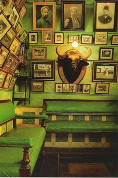 Maharaja green room. Love the intensity of this green married with old photos in wooden frames.