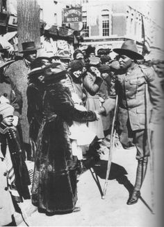 An injured soldier of the Harlem Hellfighters (the 369th Infantry Regiment) taking part in the welcome home parade, Feb 1919.