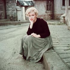 Always fashionable - Marilyn sporting a Maxi skirt.    Photographed by Milton H Greene © 2012 Joshua Greene. Marilyn MonroeTM